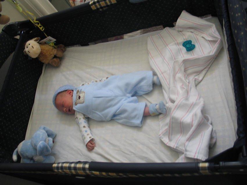 baby sleeping in a pack n play