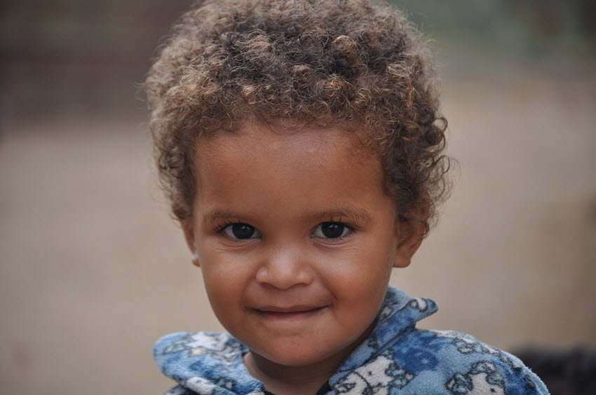 infant with curly hair