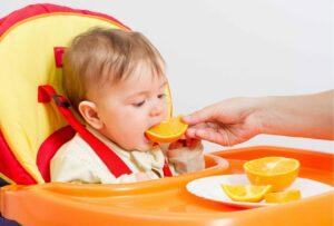 Toddler Eating Oranges