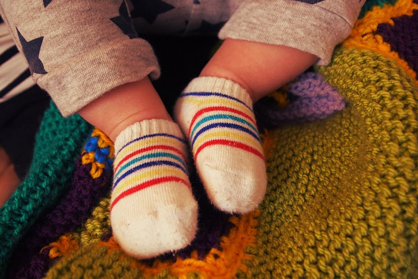 baby wearing socks to keep warm