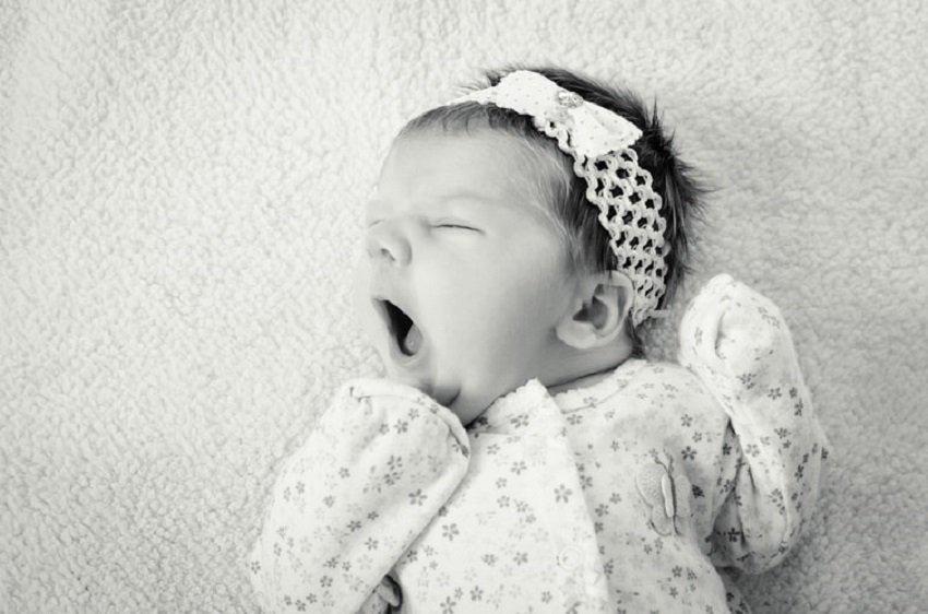 baby in sleeper