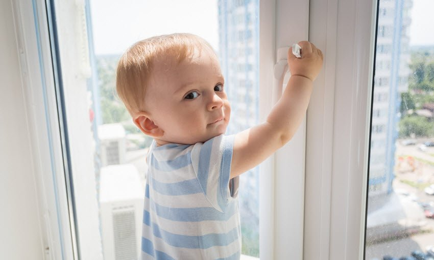Baby Boy Pulling on Window Handle
