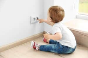 Baby Playing With Electrical Outlets