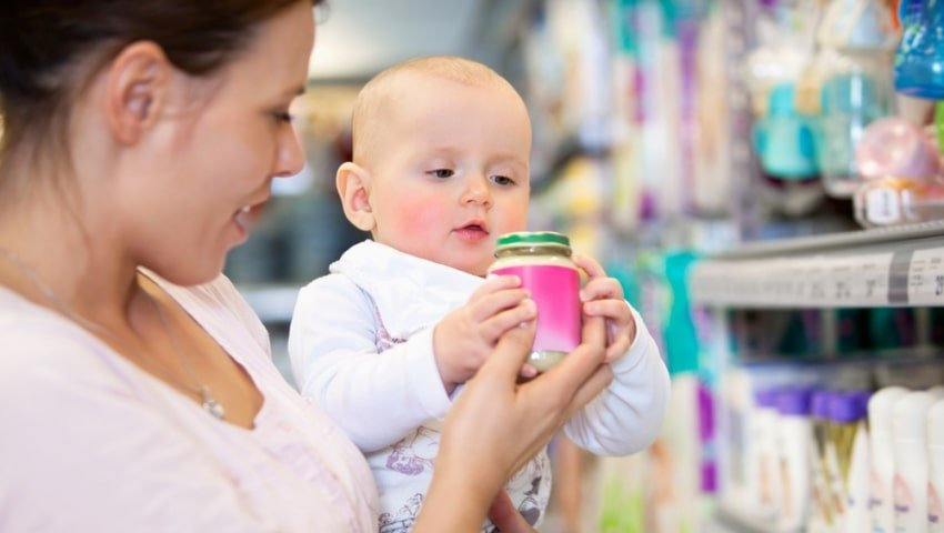 baby looking at product with mom