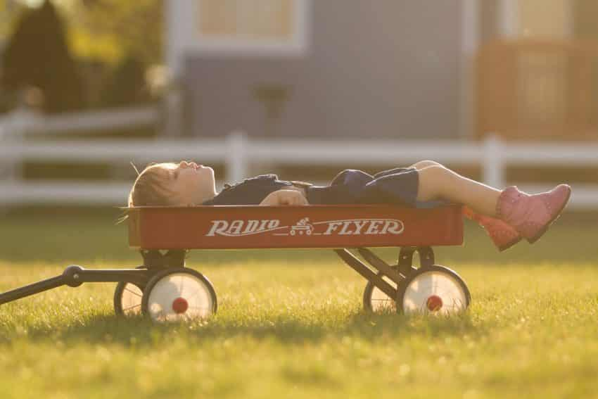 boy in a radio flyer wagon