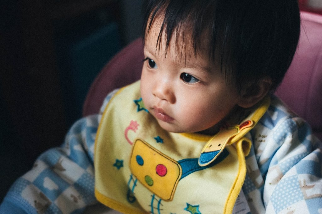baby with wearing a bib