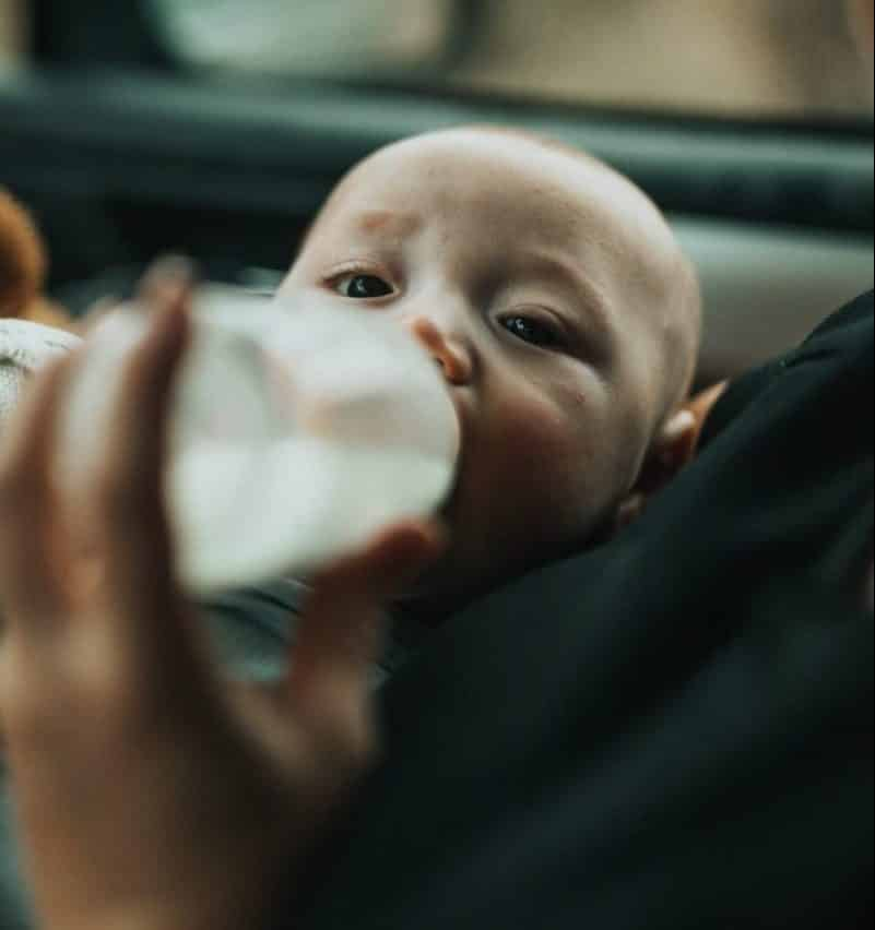 feeding baby with a bottle