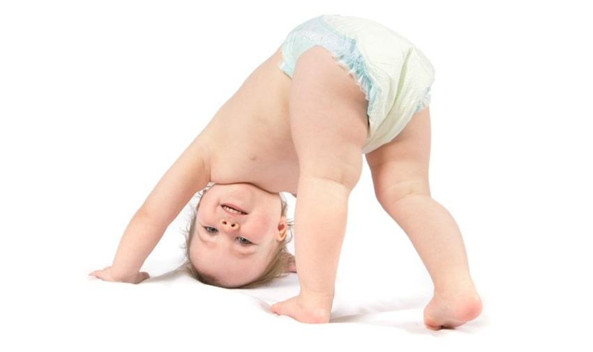 baby girl bending over
