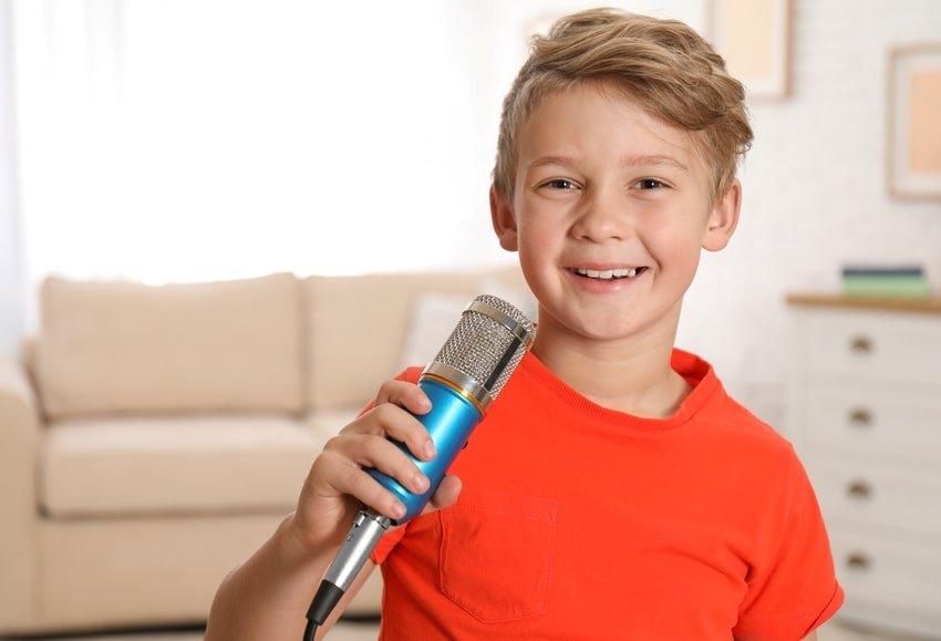 boy holding a mic