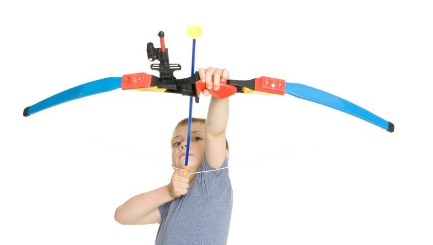 boy with bow and arrow toy