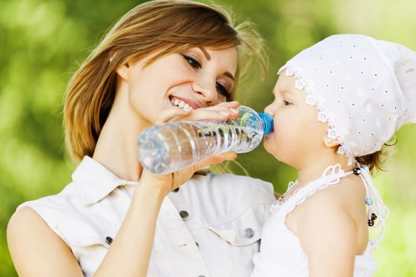 mom giving child water