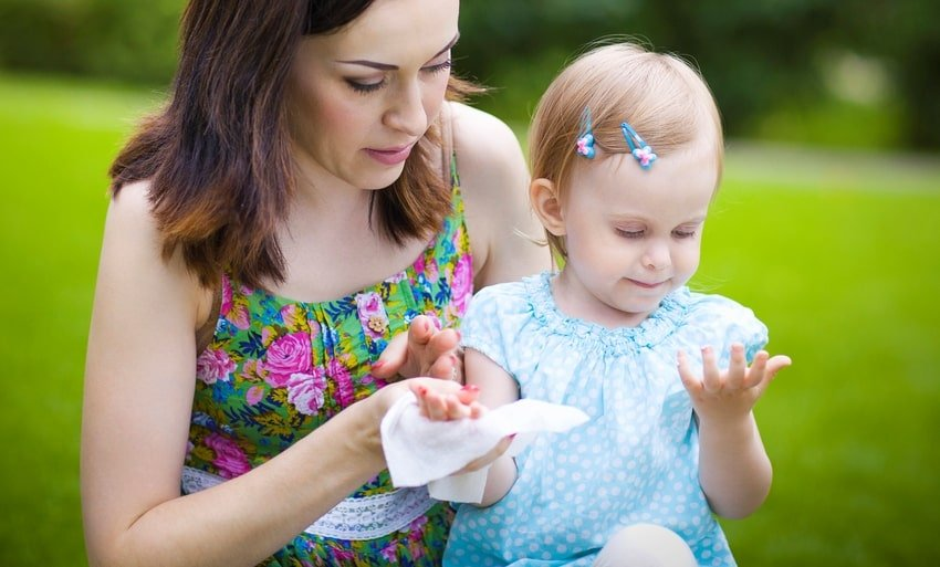 mother wiping hand of child