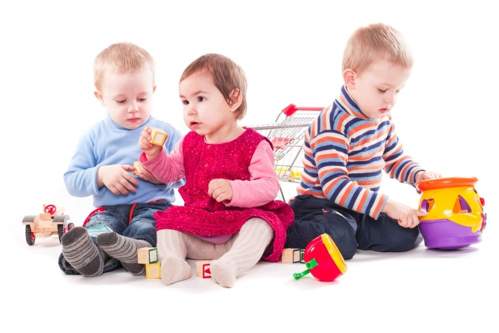 three toddlers playing