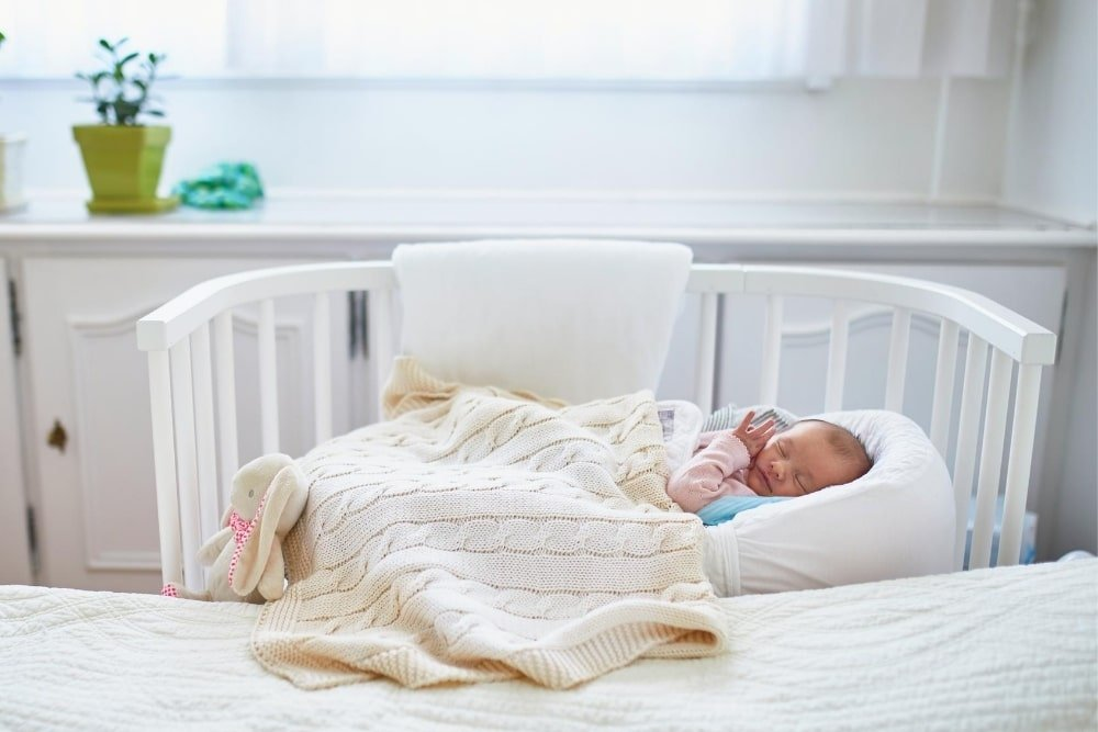 baby asleep in a bassinet