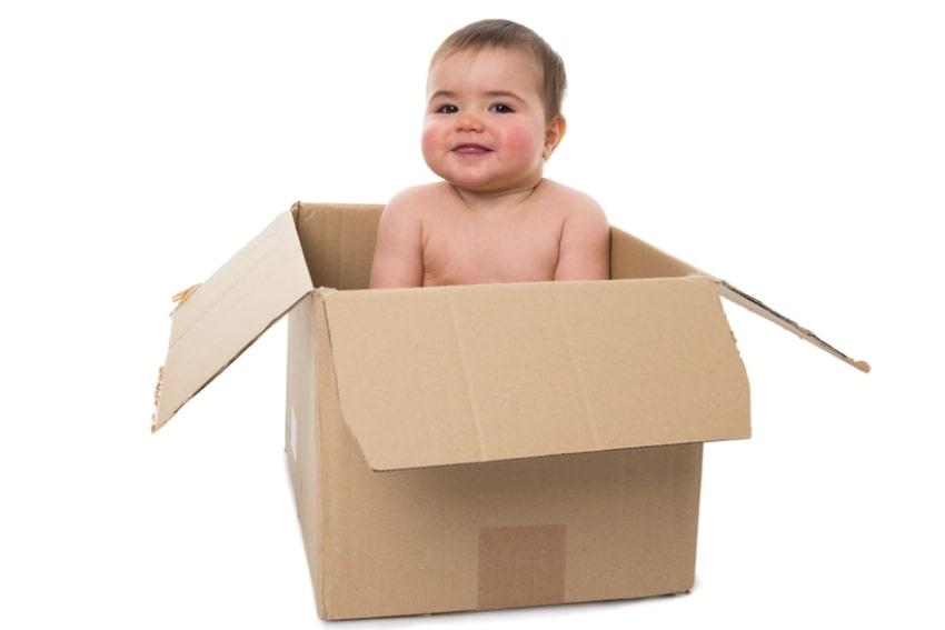 baby in a cardboard box