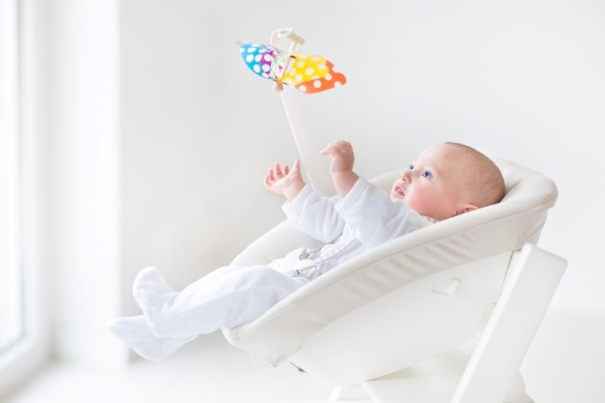 baby looking at mobile toy