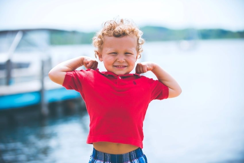 boy kid flexing