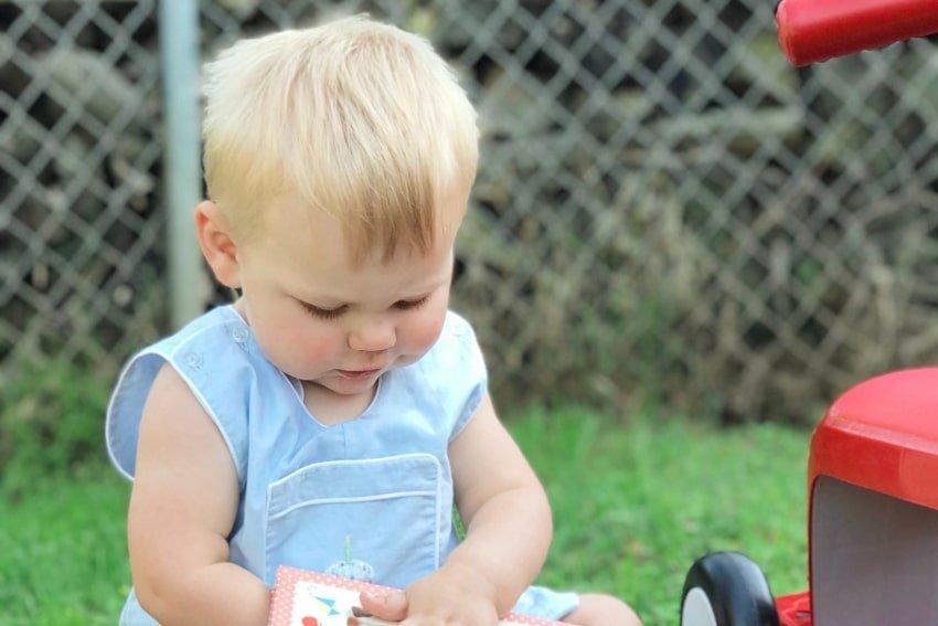 boy toddler holding a book