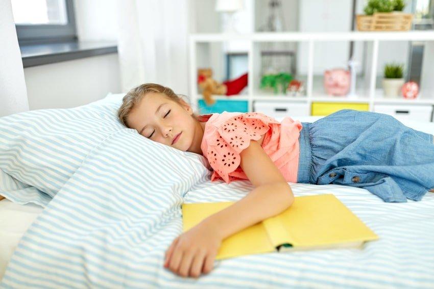 child sleeping in her room