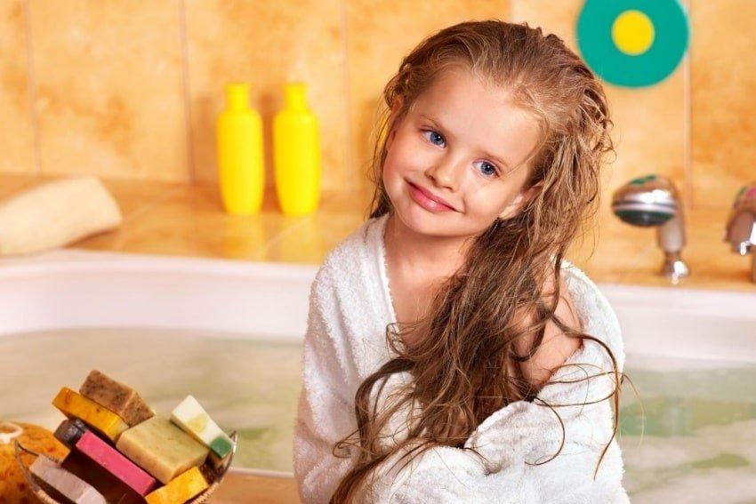 little girl with wet long hair