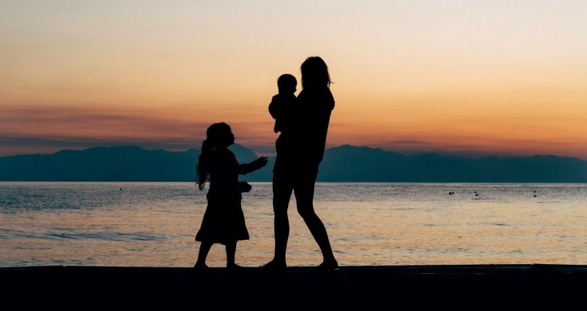 silhouette of woman with kids