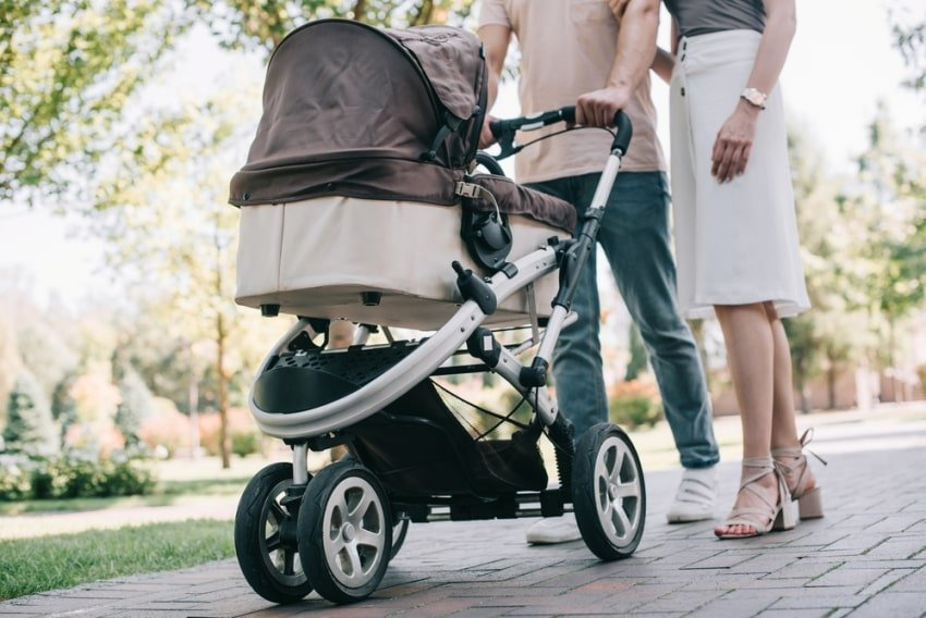 parents with their baby in the stroller