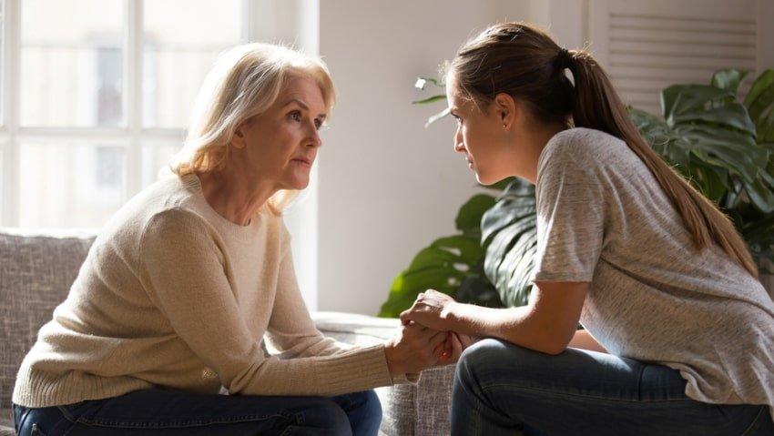 woman seeking help from older woman