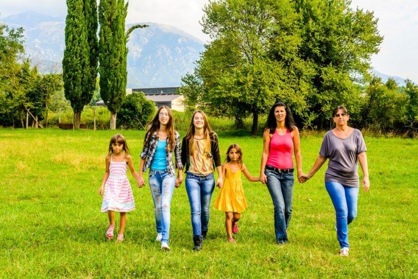 family of female members walking