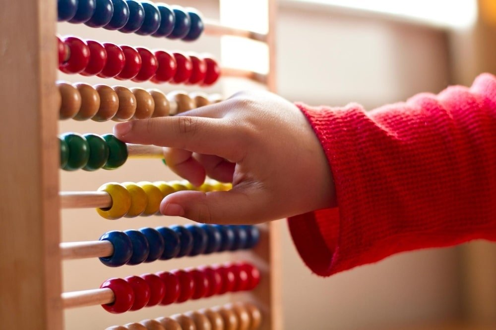 kid counting using an abacus