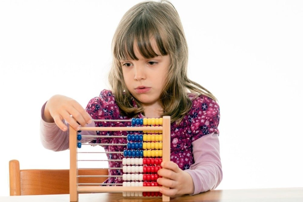 young girl counting