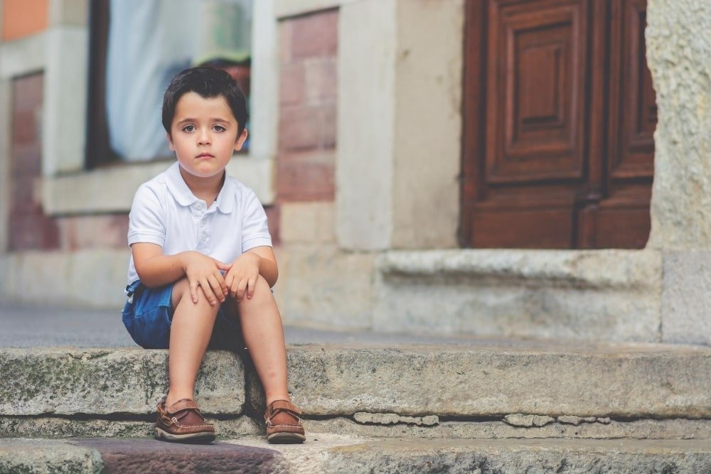 boy alone on the pavement