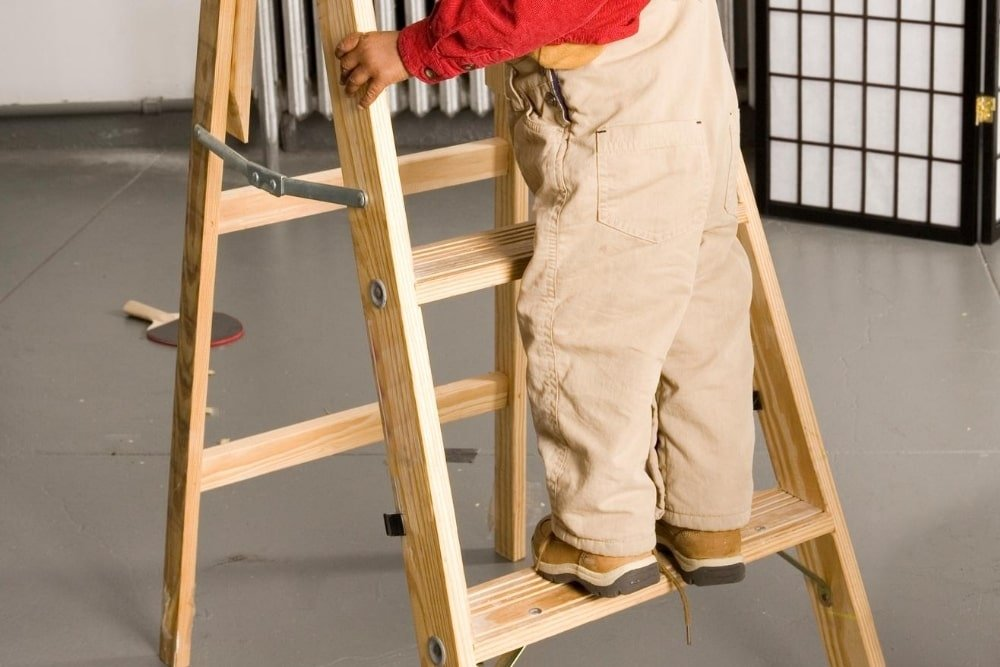 child climbing on a small ladder