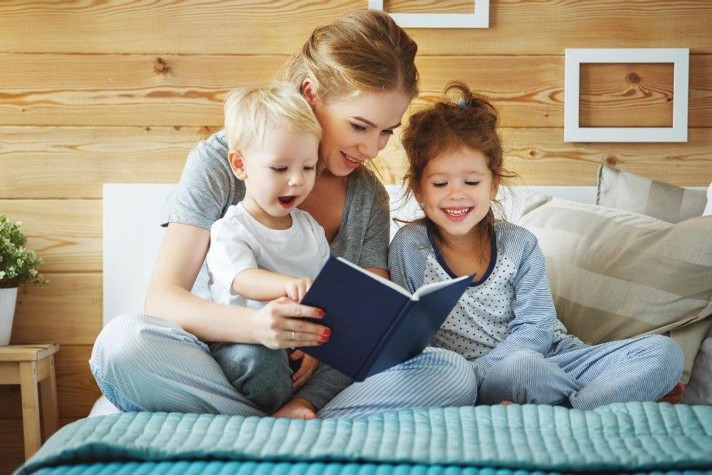mother reading with young children