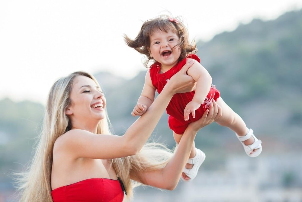 happy young mom and baby