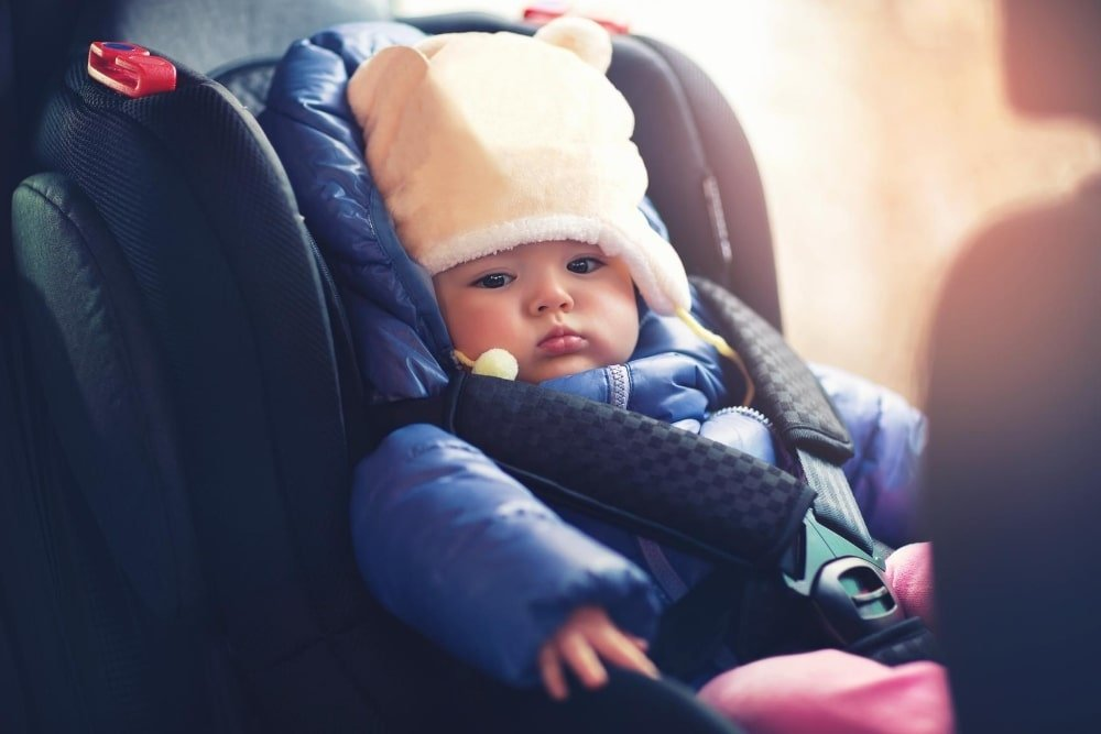 baby in an infant car seat