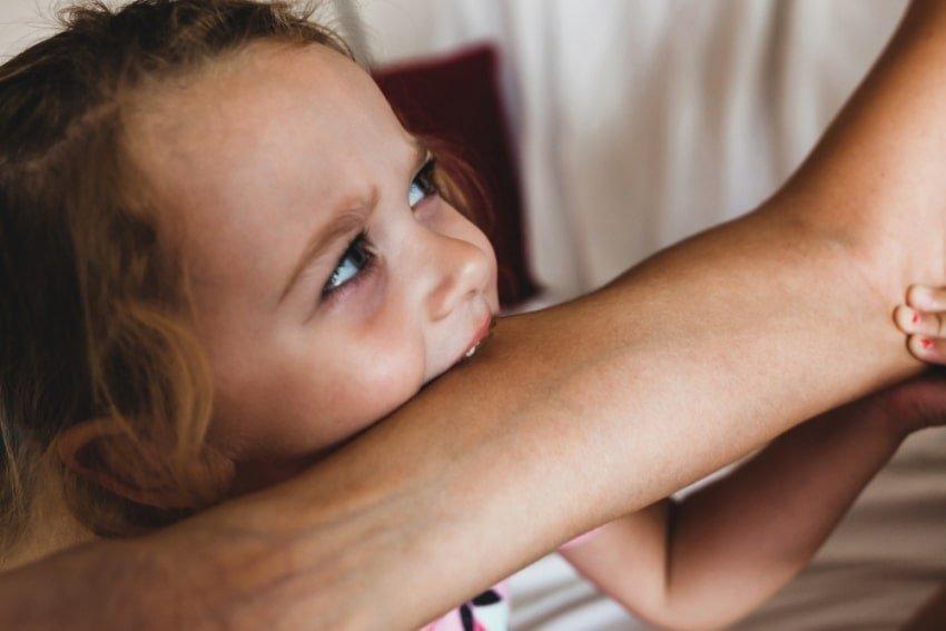 child biting