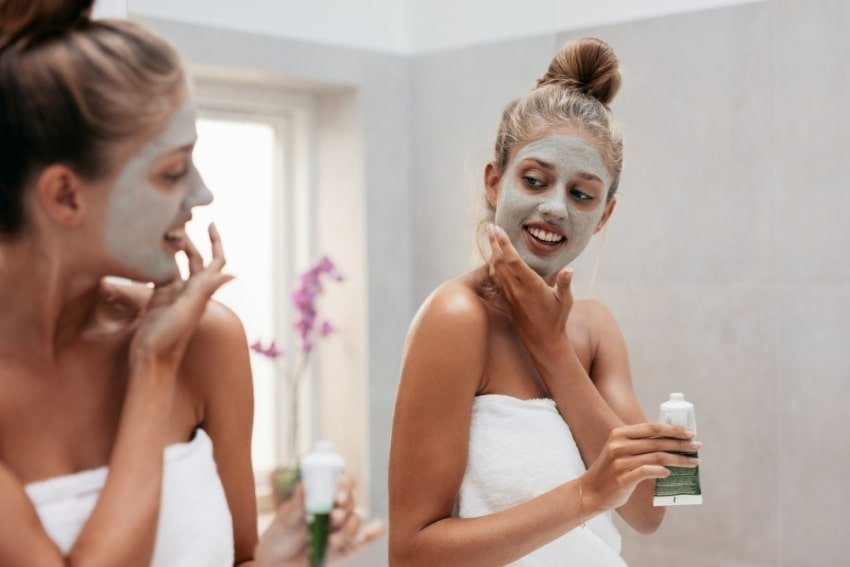 woman adding a face mask