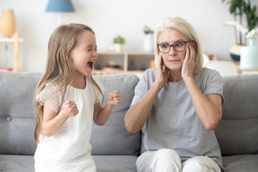 female toddler throwing a tantrum