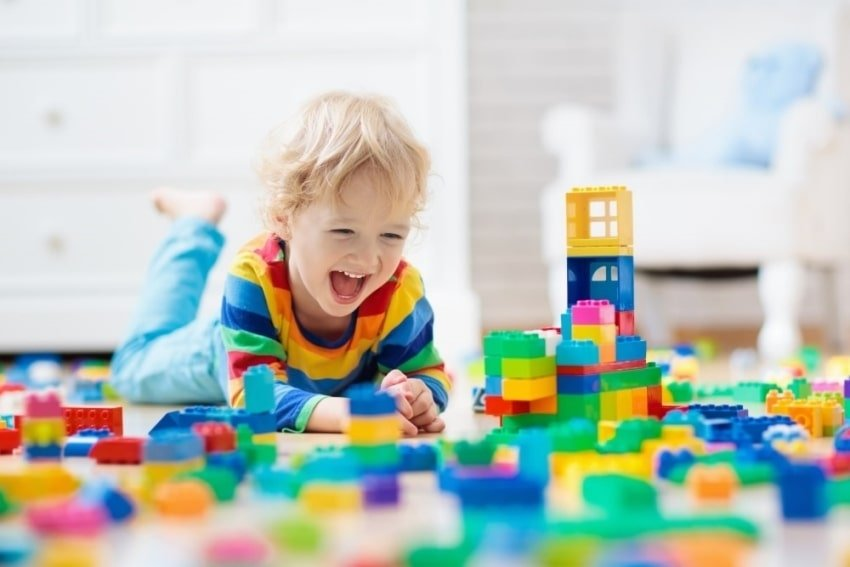 toddler happily playing
