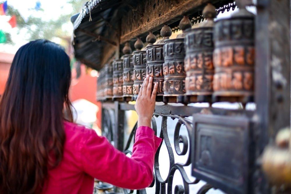 a girl doing a Buddhist ritual