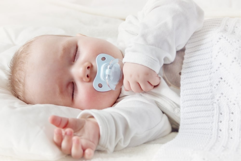 baby asleep with a pacifier