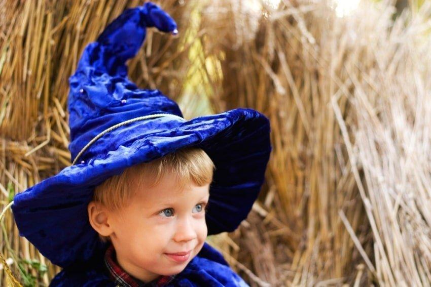 boy wearing in blue wizard hat