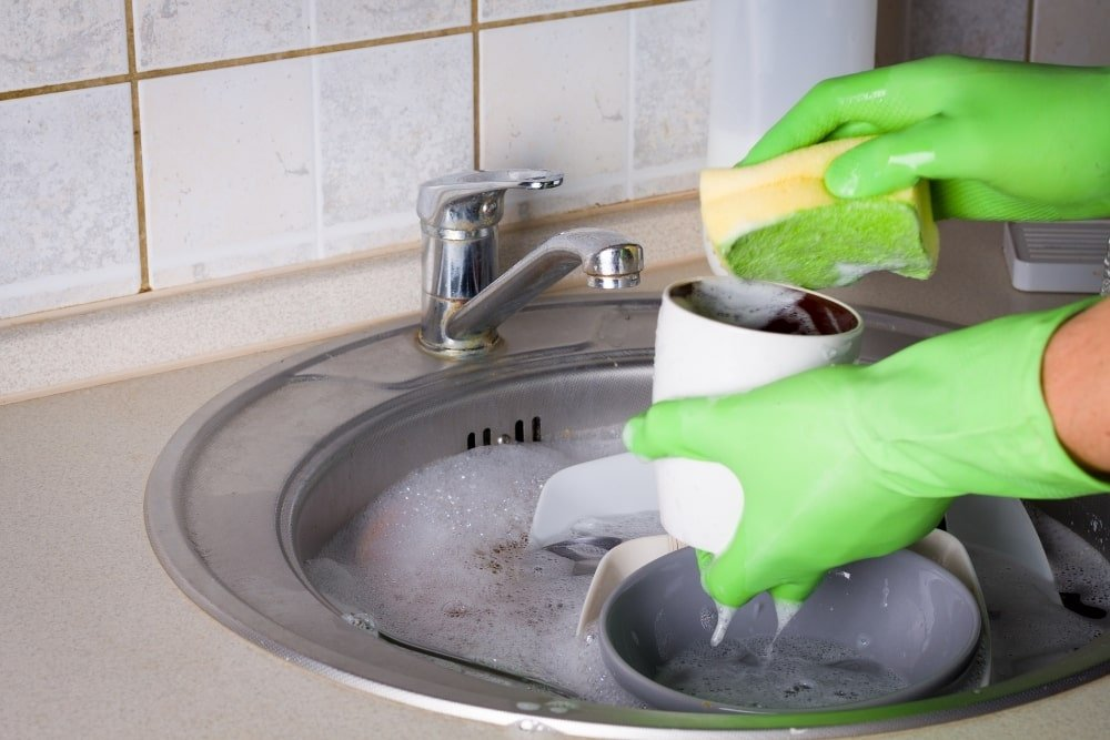 hand washing dishes