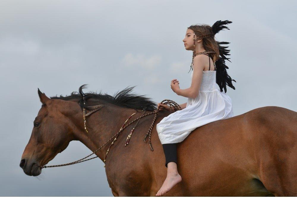 native american girl on a horse