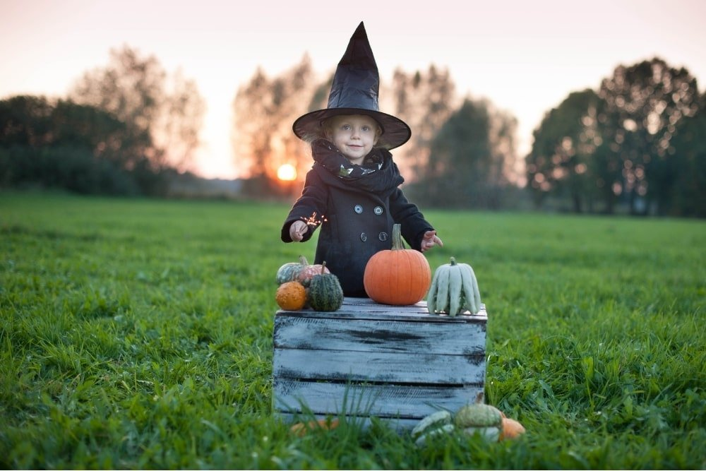 toddler dressed as a witch