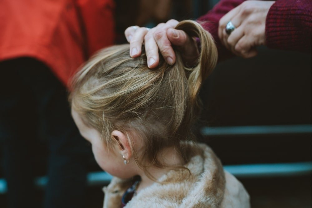 toddler hair being styled