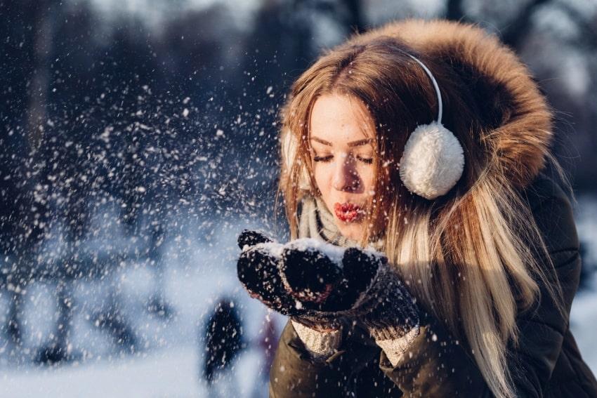 Polish lady blowing snow