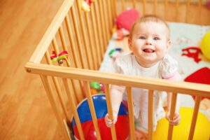 Is Your Toddler Climbing Out of the Crib But Isn't Ready for a Bed? (5 Solutions)