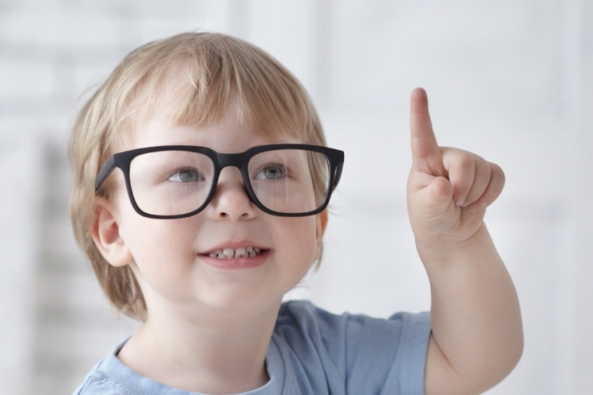little boy wearing glasses