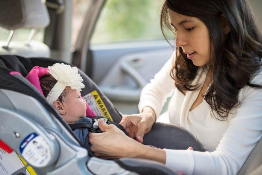 mother and baby in an infant car seat